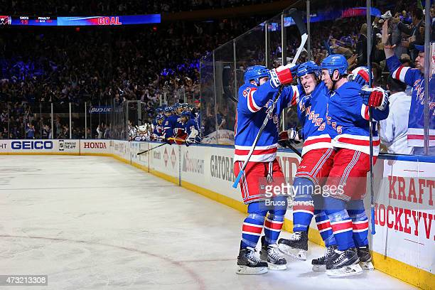 Kevin Hayes of the New York Rangers celebrates with his teammates after scoring a goal in the second period against the Washington Capitals in Game...