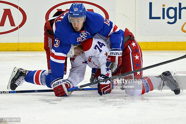 Kevin Hayes of the New York Rangers gets tangled up with John Carlson of the Washington Capitals in Game Seven of the Eastern Conference Semifinals...