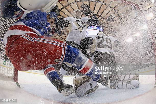 Kevin Hayes of the New York Rangers is checked into the net during the first period against the Pittsburgh Penguins in Game One of the Eastern...