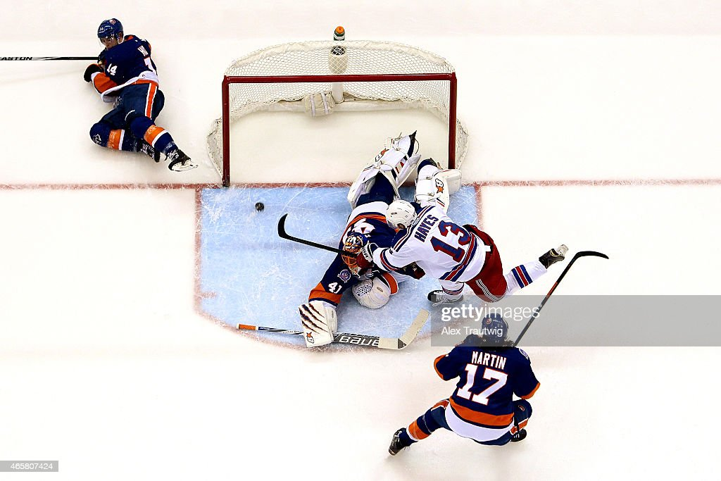 Kevin Hayes #13 of the New York Rangers scores a goal in the second period on Jaroslav Halak #41 of the New York Islanders during a game at the Nassau Veterans Memorial Coliseum on March 10, 2015 in Uniondale, New York.