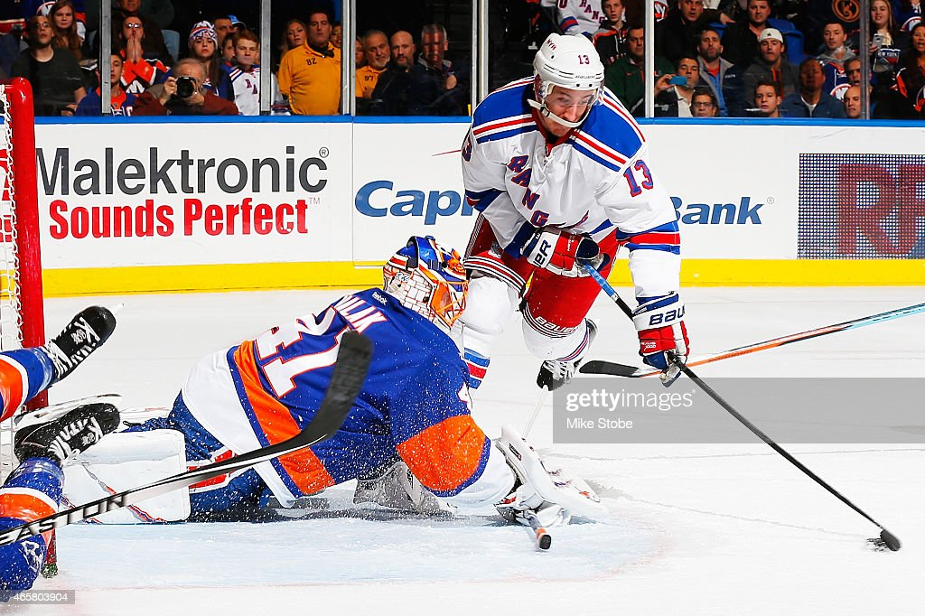 Kevin Hayes #13 of the New York Rangers scores a second period goal past Jaroslav Halak #41 of the New York Islanders at Nassau Veterans Memorial Coliseum on March 10, 2015 in Uniondale, New York.