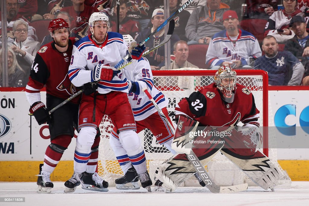 Kevin Hayes #13 of the New York Rangers sets up in fromt of goaltender Antti Raanta #32 of the Arizona Coyotes during the thrid period of the NHL game at Gila River Arena on January 6, 2018 in Glendale, Arizona. The Rangers defeated the Coyotes 2-1 in an overtime shootout.