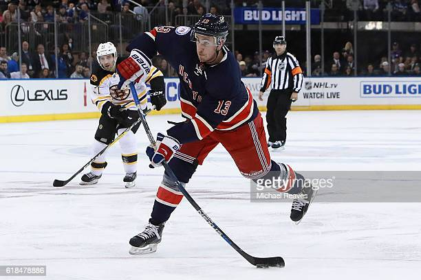 Kevin Hayes of the New York Rangers shoots a shot on goal against the Boston Bruins during the second period at Madison Square Garden on October 26...