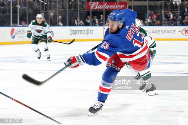 Kevin Hayes of the New York Rangers shoots the puck against the Minnesota WIld at Madison Square Garden on February 21 2019 in New York City
