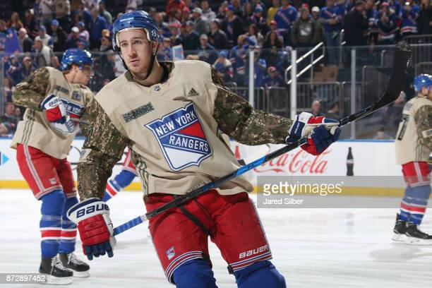 Kevin Hayes of the New York Rangers sports a special jersey during warmups in honor of Veterans Day prior to the game against the Edmonton Oilers at...