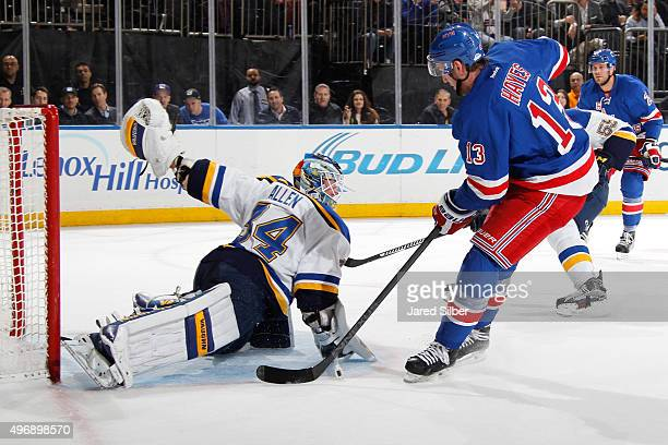 Kevin Hayes of the New York Rangers tucks the puck past Jake Allen of the St Louis Blues for a goal in the first period at Madison Square Garden on...