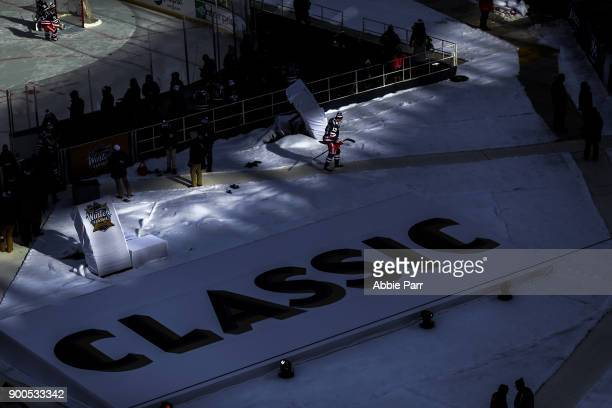 Kevin Hayes of the New York Rangers walks across Citi Field prior to the 2018 Bridgestone NHL Winter Classic at Citi Field on January 1 2018 in the...