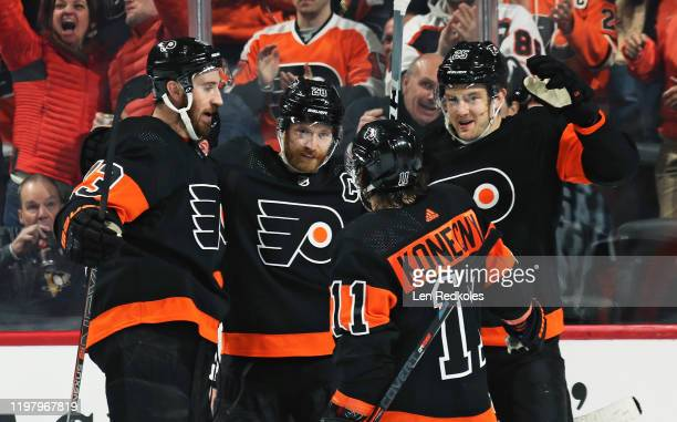 Kevin Hayes of the Philadelphia Flyers celebrates his first period power-play goal against the Colorado Avalanche with Claude Giroux, Travis Konecny,...