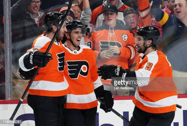 Kevin Hayes of the Philadelphia Flyers celebrates his second period shorthanded goal against the Washington Capitals with Matt Niskanen and Ivan...