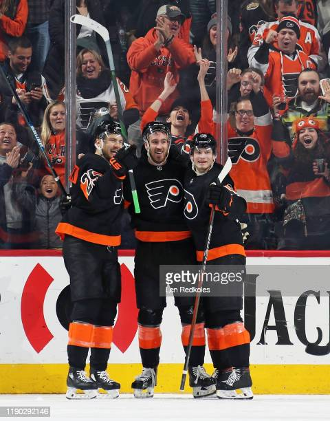 Kevin Hayes of the Philadelphia Flyers celebrates his third period goal, his second of the game against the New York Rangers, with teammates James...