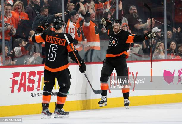 Kevin Hayes of the Philadelphia Flyers celebrates his third period shorthanded goal against the Colorado Avalanche with Travis Sanheim on February 1,...