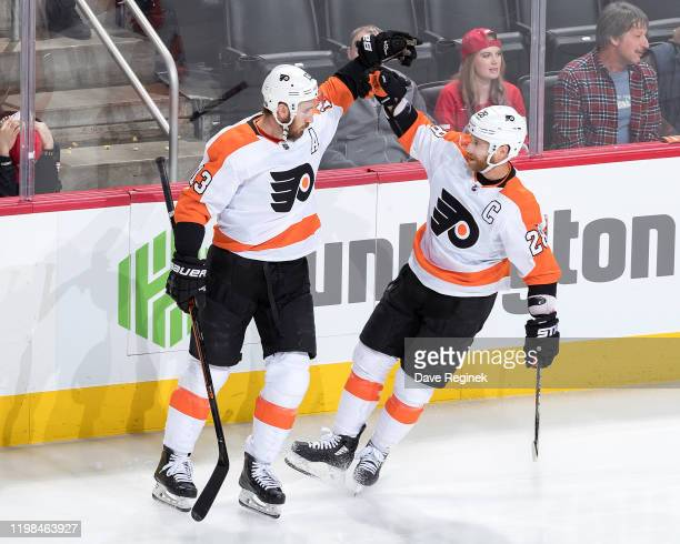 Kevin Hayes of the Philadelphia Flyers celebrates his third period goal with teammate Claude Giroux during an NHL game against the Detroit Red Wings...