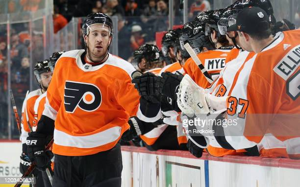 Kevin Hayes of the Philadelphia Flyers celebrates his third period goal against the San Jose Sharks with his teammates on the bench on February 25,...