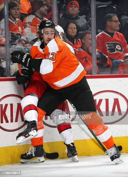 Kevin Hayes of the Philadelphia Flyers checks a member of the Carolina Hurricanes along the boards on November 5, 2019 at the Wells Fargo Center in...