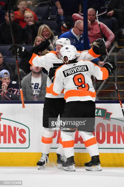 Kevin Hayes of the Philadelphia Flyers is congratulated by Ivan Provorov after scoring the game winning goal in overtime against the Columbus Blue...