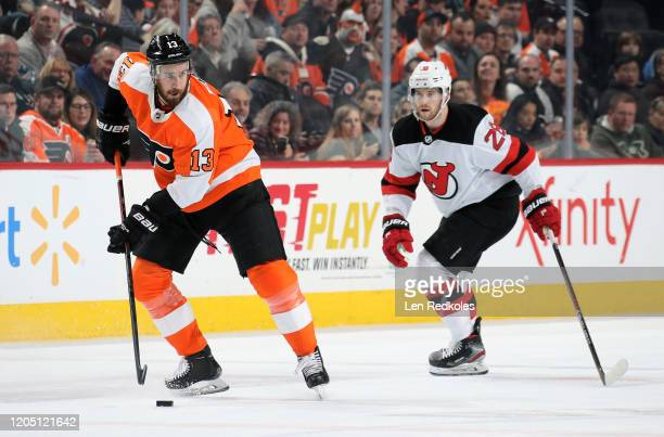 Kevin Hayes of the Philadelphia Flyers skates the puck against Damon Severson of the New Jersey Devils on February 6, 2020 at the Wells Fargo Center...