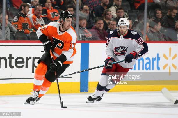Kevin Hayes of the Philadelphia Flyers skates the puck against Oliver Bjorkstrand of the Columbus Blue Jackets on February 18, 2020 at the Wells...