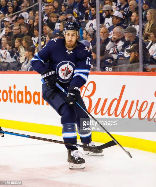 Kevin Hayes of the Winnipeg Jets follows the play around the boards during second period action against the Boston Bruins at the Bell MTS Place on...