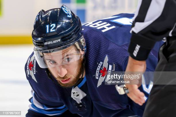 Kevin Hayes of the Winnipeg Jets gets set during a second period faceoff against the St Louis Blues in Game Five of the Western Conference First...