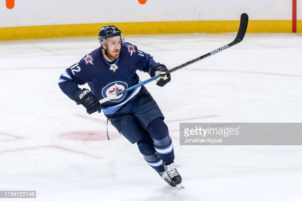 Kevin Hayes of the Winnipeg Jets keeps an eye on the play during second period action against the Nashville Predators at the Bell MTS Place on March...