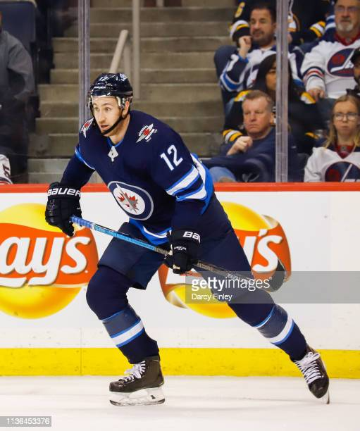 Kevin Hayes of the Winnipeg Jets keeps an eye on the play during second period action against the Boston Bruins at the Bell MTS Place on March 14...