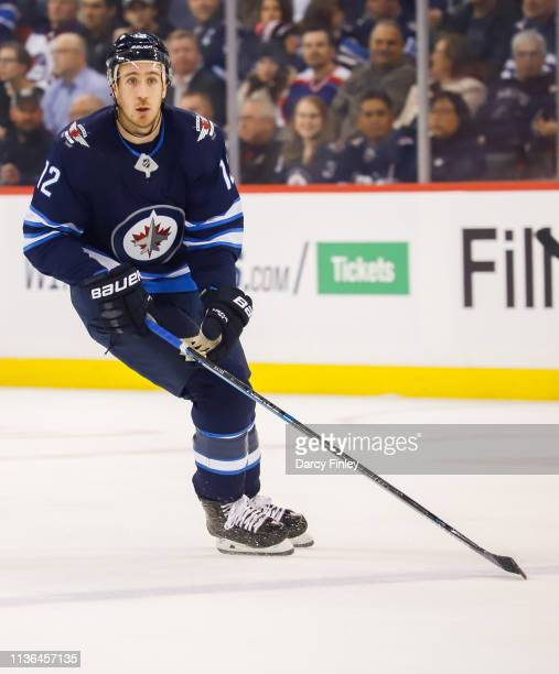 Kevin Hayes of the Winnipeg Jets keeps an eye on the play during first period action against the San Jose Sharks at the Bell MTS Place on March 12...