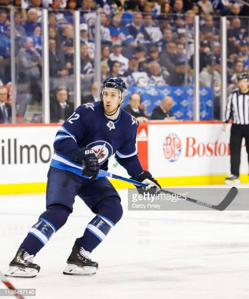 Kevin Hayes of the Winnipeg Jets keeps an eye on the play during second period action against the San Jose Sharks at the Bell MTS Place on March 12...