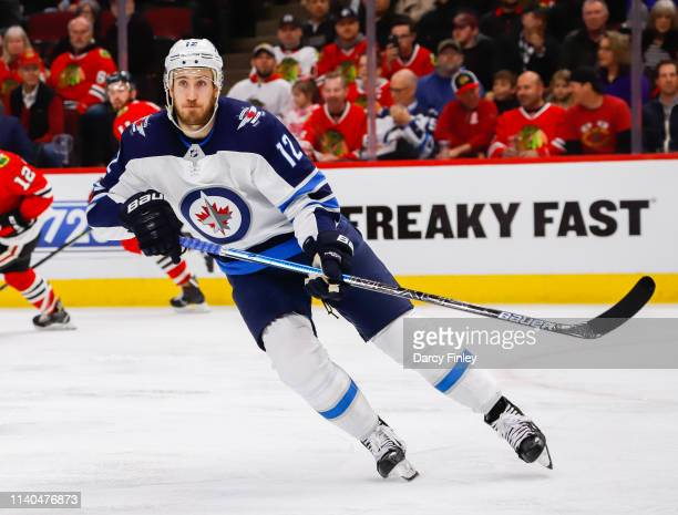 Kevin Hayes of the Winnipeg Jets keeps an eye on the play during third period action against the Chicago Blackhawks at the United Center on April 1...