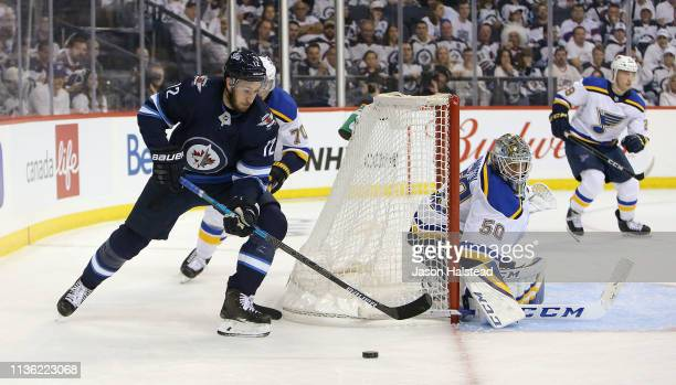 Kevin Hayes of the Winnipeg Jets looks for a wraparound against Jordan Binnington of the St Louis Blues in Game One of the Western Conference First...