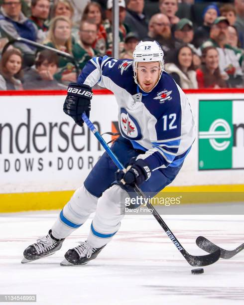 Kevin Hayes of the Winnipeg Jets plays the puck down the ice during first period action against the Minnesota Wild at the Xcel Energy Center on April...