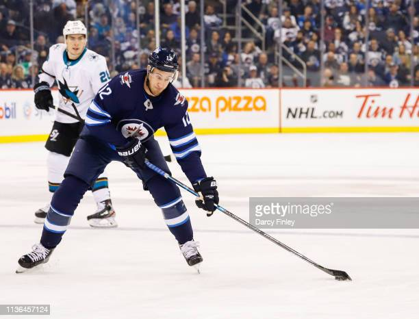 Kevin Hayes of the Winnipeg Jets plays the puck down the ice during second period action against the San Jose Sharks at the Bell MTS Place on March...