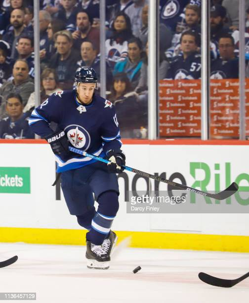 Kevin Hayes of the Winnipeg Jets plays the puck down the ice during first period action against the San Jose Sharks at the Bell MTS Place on March 12...