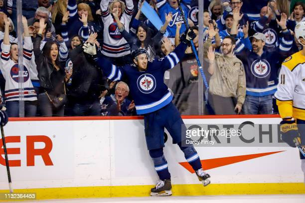 Kevin Hayes of the Winnipeg Jets raises his arms in celebration after scoring a second period goal against the Nashville Predators at the Bell MTS...