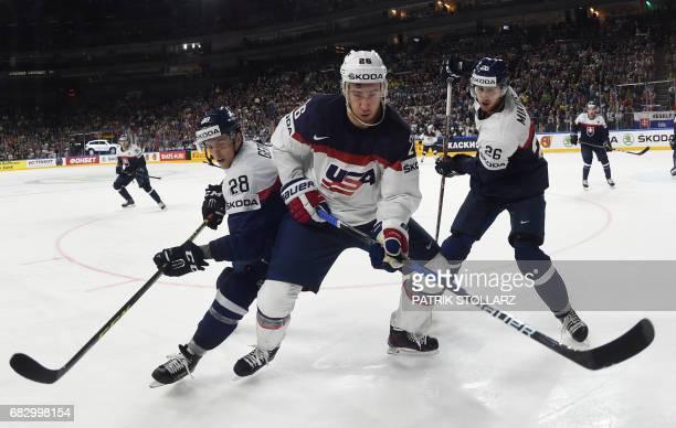 Kevin Hayes , Slovakia´s Martin Gernat and Slovakia´s Juraj Mikus vie during the IIHF Ice Hockey World Championships first round match between...