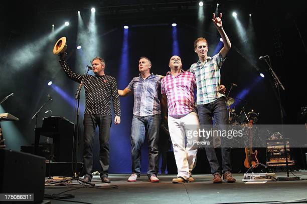 Kevin Hearn Ed Robertson Tyler Stewart and Jim Creegan of Barenaked Ladies perform when the Barenaked Ladies headline a benefit concert for Celebrate...