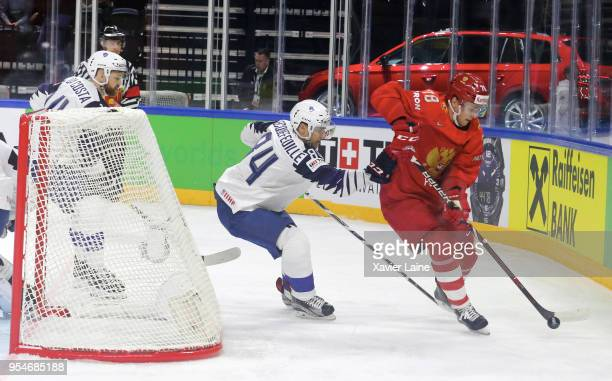 Kevin Hecquefeuille of France in acton with Maxim Mamin of Russia during the 2018 IIHF Ice Hockey World Championship Group A between Russia and...