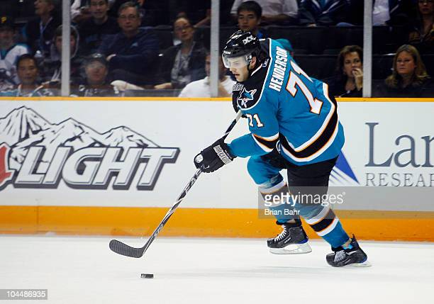 Kevin Henderson of the San Jose Sharks advances the puck against the Phoenix Coyotes in a preseason splitsquad game at HP Pavilion on September 25...