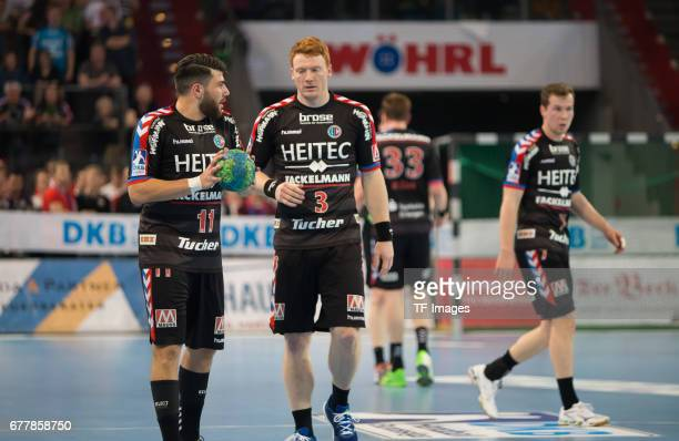 Kevin Herbst of Erlangen speak with Nicolai Theilinger of Erlangen during the match between the HC Erlangen and the RheinNeckar Loewen on April 30...