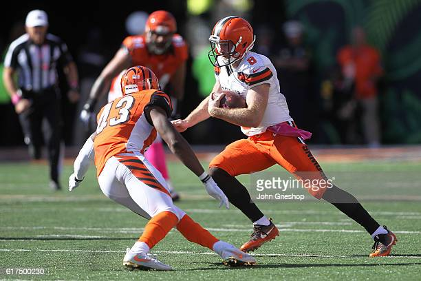 Kevin Hogan of the Cleveland Browns attempts to run the ball past George Iloka of the Cincinnati Bengals during the third quarter at Paul Brown...