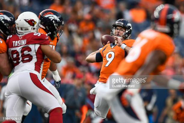 Kevin Hogan of the Denver Broncos passes against the Arizona Cardinals during the first quarter of a preseason National Football League game at...