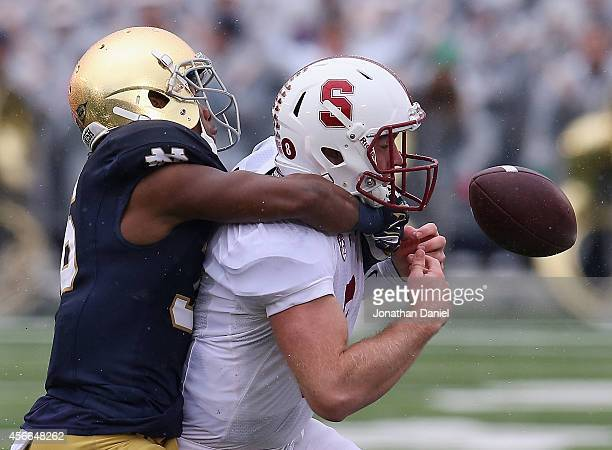 Kevin Hogan of the Standford Cardinal fumbles the ball out of bounds as he is hit by Cole Luke of the Notre Dame Fighting Irish at Notre Dame Stadium...