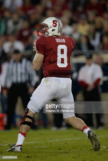 Kevin Hogan of the Stanford Cardinal drops back to pass against the Notre Dame Fighting Irish at Stanford Stadium on November 30, 2013 in Palo Alto,...