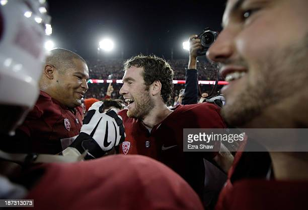 Kevin Hogan of the Stanford Cardinal is congratulated by David Yankey of the Stanford Cardinal after Stanford beat the Oregon Ducks at Stanford...