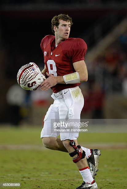 Kevin Hogan of the Stanford Cardinal runs back onto the field after a timeout against the Notre Dame Fighting Irish at Stanford Stadium on November...