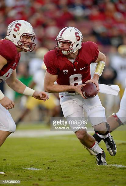 Kevin Hogan of the Stanford Cardinal turns to hand the ball off to a running back against the Notre Dame Fighting Irish at Stanford Stadium on...