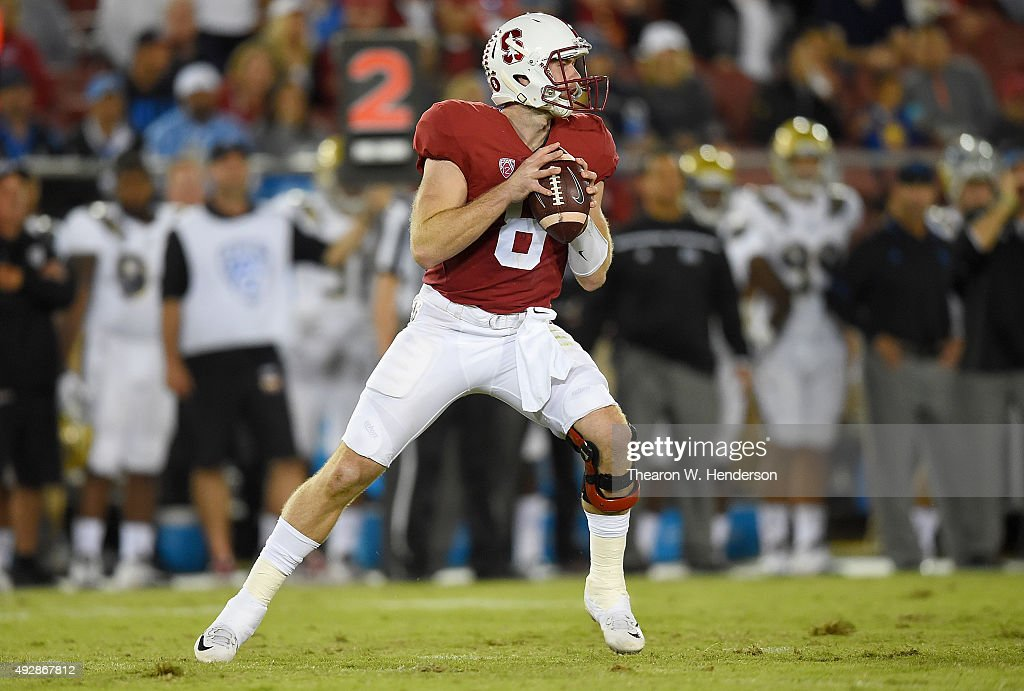 Kevin Hogan #8 of the Stanford Cardinal's looks to throw a pass against the UCLA Bruins in the third quarter of an NCAA football game at Stanford Stadium on October 15, 2015 in Stanford, California.