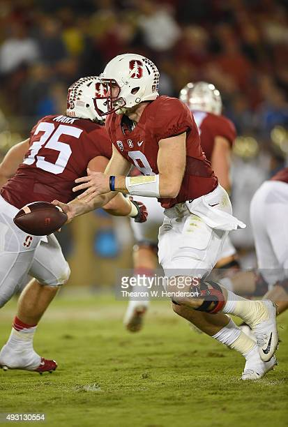 Kevin Hogan of the Stanford Cardinal's turns to hand the ball off to a running back against the UCLA Bruins in the third quarter of an NCAA football...