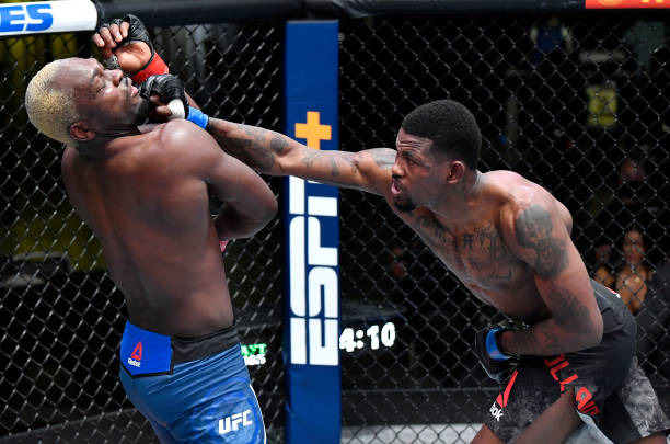 Kevin Holland punches Derek Brunson in their middleweight fight during the UFC Fight Night event at UFC APEX on March 20, 2021 in Las Vegas, Nevada.