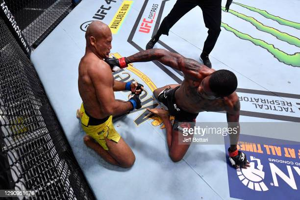 Kevin Holland punches Jacare Souza of Brazil in their middleweight bout during the UFC 256 event at UFC APEX on December 12, 2020 in Las Vegas,...