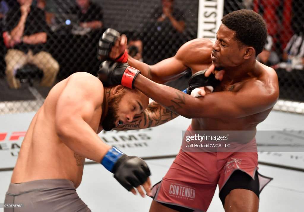 Kevin Holland punches Will Santiago in their middleweight bout during Dana White's Tuesday Night Contender Series at the TUF Gym on June 12, 2018 in Las Vegas, Nevada.